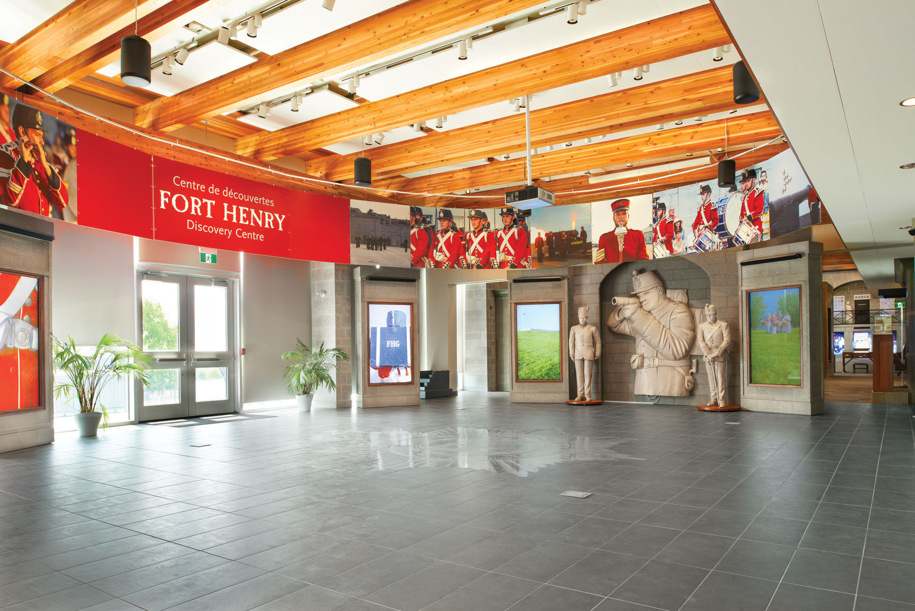 Entry Lobby with photos and relief of soldiers and wood rafter ceilings
