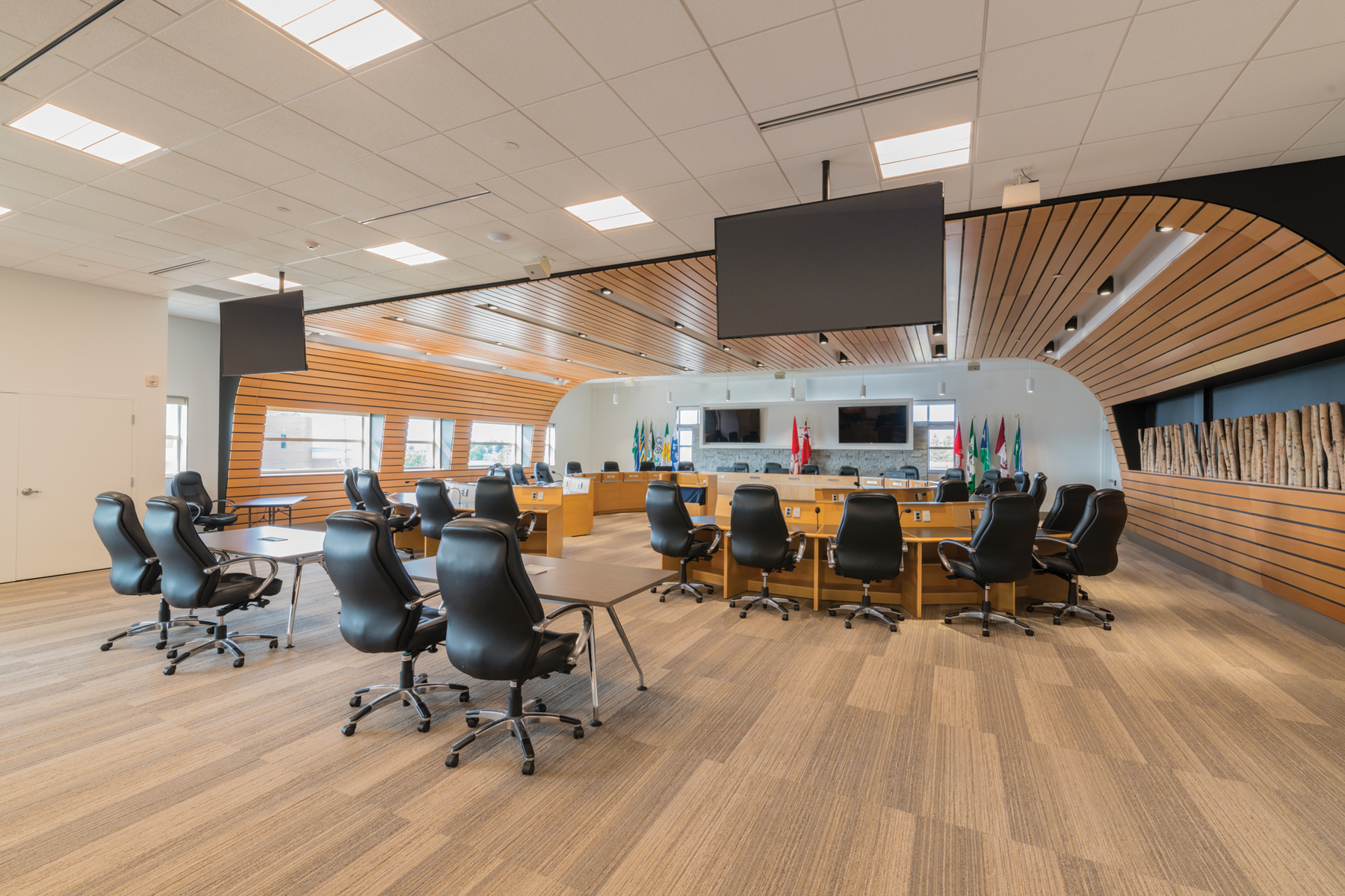 Council chamber with wood panel feature curving along walls and ceiling