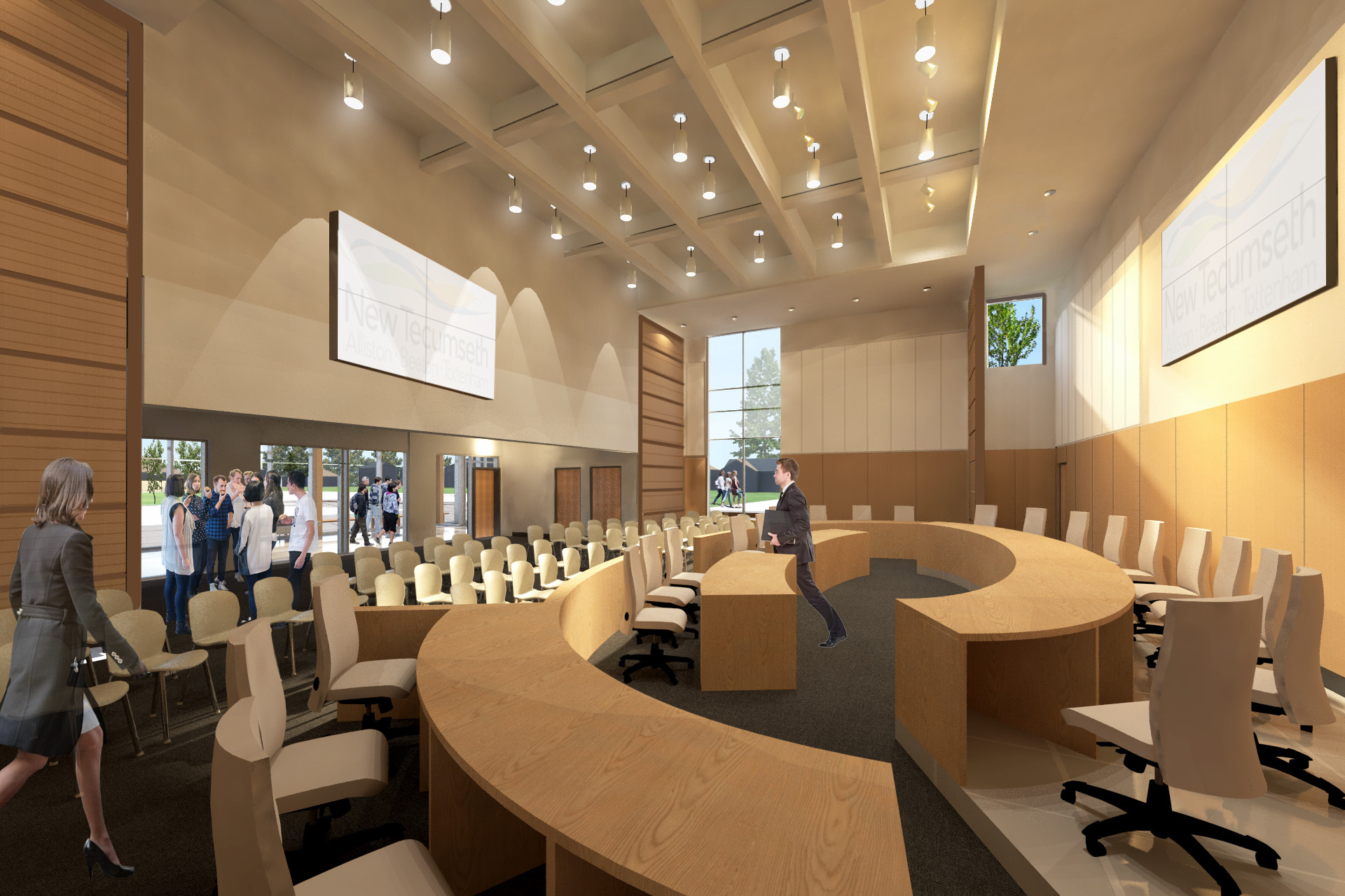 Council chamber with semi circle wood tables with white chairs, large wall mounted screens and paneled ceiling