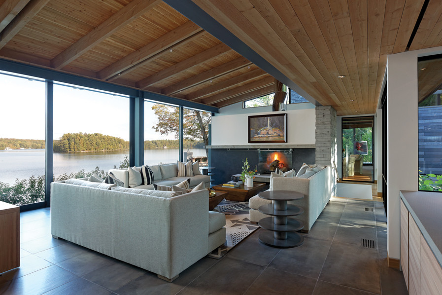 Living Room with fireplace overlooking Lake Joseph, Muskoka