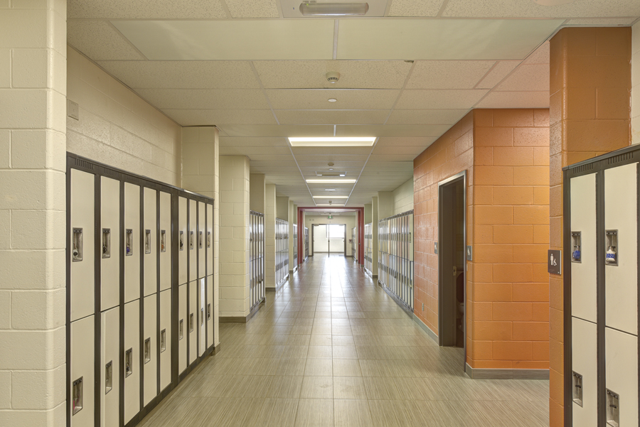 Classroom corridor with white black-framed lockers and