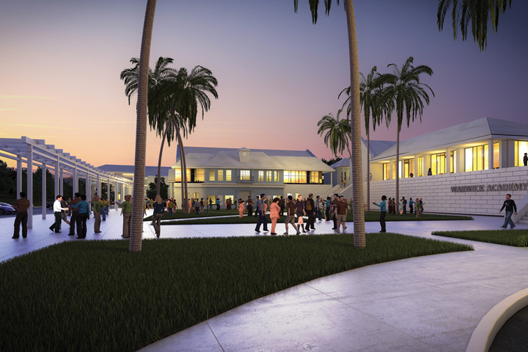 Paved plaza with colonnade and palm trees surrounded by illuminated Academy complex with staircase leading to front entrance at dusk