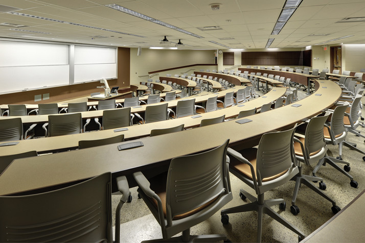 Six-tier lecture hall with rolling chairs and curved desks
