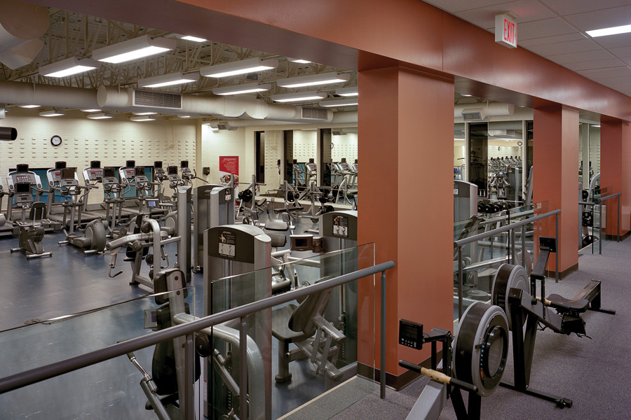 Two tiered orange fitness room with fitness equipment