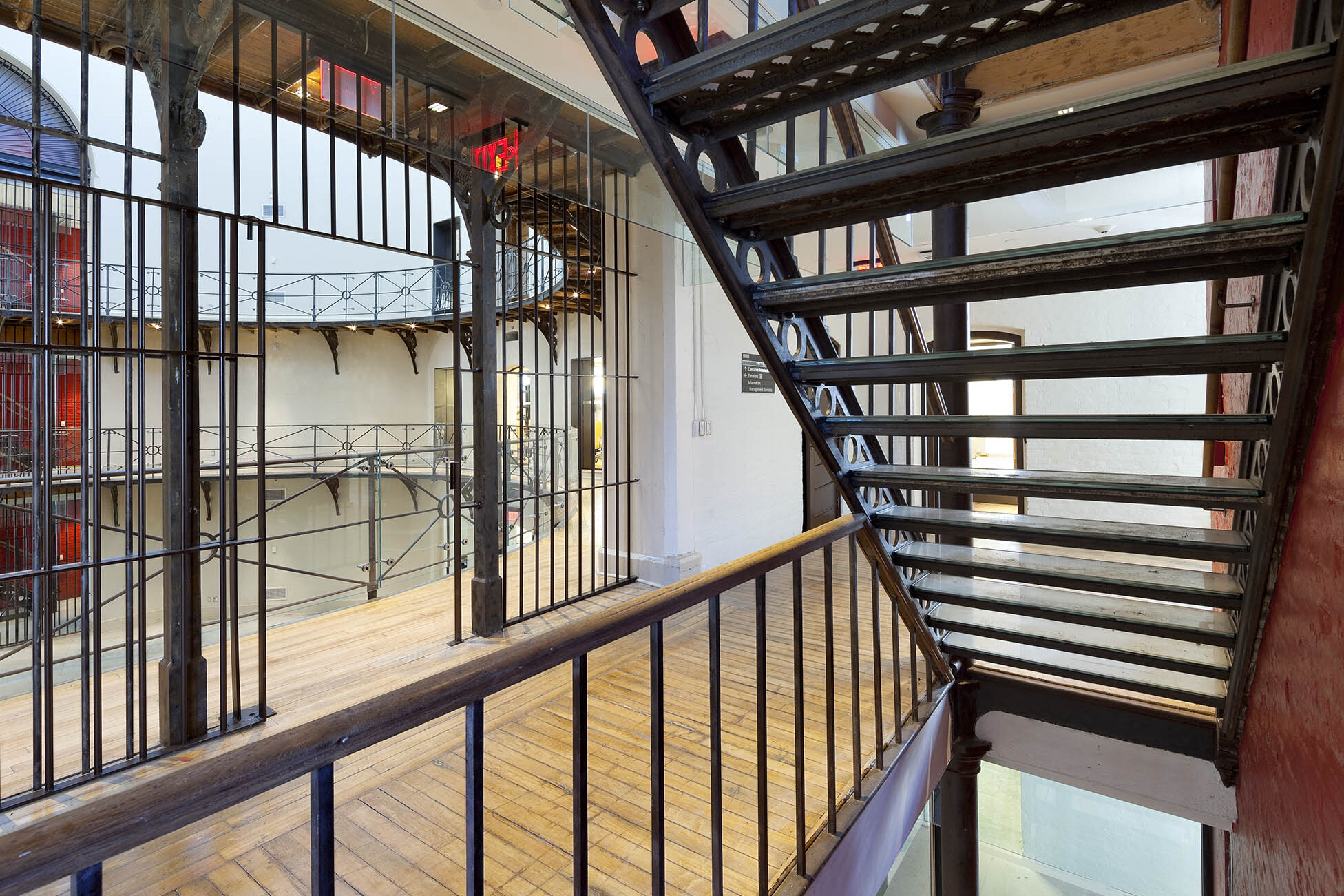 Open original copper staircase with railing connecting three floors