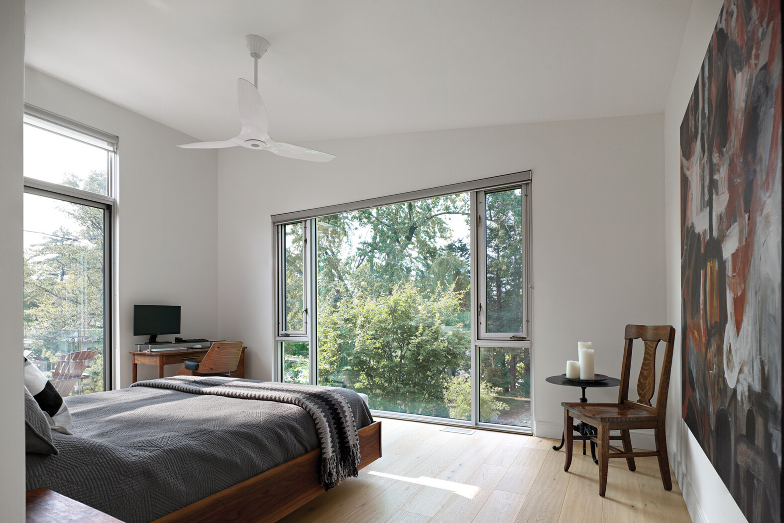 Second storey addition bedroom with large windows looking out to tree filled backyard
