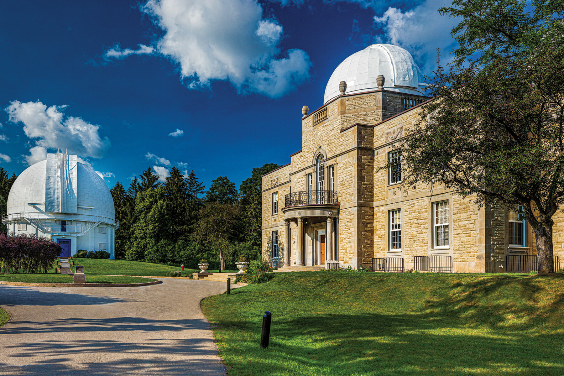 View of Observatory on left and Administration Building on right from down entry lane on a sunny day