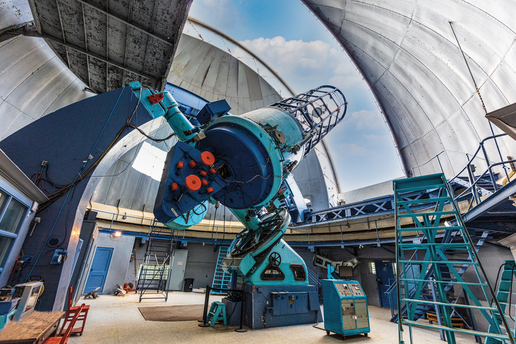 View of telescope from inside observatory with open dome